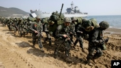South Korean Marines take part in a landing exercise during joint US-South Korean military training last year. This year's exercises known as Key Resolve and Foal Eagle are expected to be the largest ever.