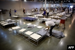 Volunteers set up additional cots for Hurricane Harvey evacuees at the NRG Center in Houston, Texas, Aug. 31, 2017.