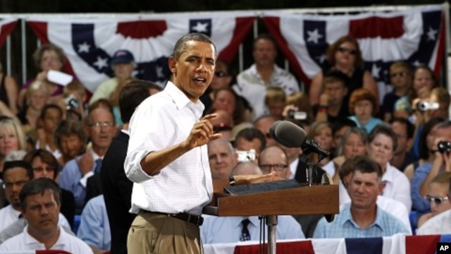 President Barack Obama speaks during a town hall-style meeting in Cannon Falls, Minnesota, August 15, 2011.
