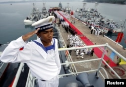 FILE- A Cambodian Navy sailor salutes on a Chinese naval patrol boat during a handover ceremony at a Cambodian naval base at Ream in Sihanoukville province, southwest of Phnom Penh, November 7, 2007.