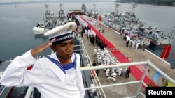 FILE PHOTO - A Cambodian Navy sailor salutes on a Chinese naval patrol boat during a handover ceremony at a Cambodian naval base at Ream in Sihanoukville province, southwest of Phnom Penh, November 7, 2007. (REUTERS/Chor Sokunthea)