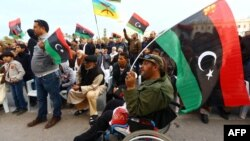 """Libyan protesters take part in a rally in support of """"Fajr Libya"""" (Libya Dawn), a mainly Islamist alliance, in Tripoli's central Martyr's Square, Feb. 13, 2015."""