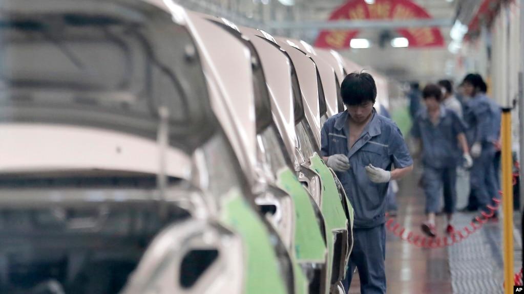 贸易战阴云之下中国制造业再现疲态(图)