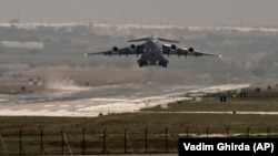 FILE - A U.S. Air Force plane takes off from the Incirlik airbase, southern Turkey.