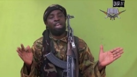 In this  photo taken from video by Nigeria's Boko Haram terrorist network, Monday May 12, 2014 shows their  leader Abubakar Shekau speaking to the camera