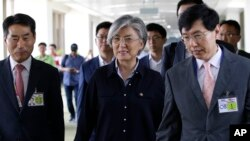 South Korean Foreign Minister Kang Kyung-wha, center, is escorted as she arrives to attend the 50th ASEAN Foreign Ministers' Meeting and its dialogue partners at the airport in Manila, Philippines, Aug. 5, 2017.