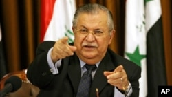 FILE - Then Iraqi president Jalal Talabani talks to reporters in Baghdad, Iraq, Aug. 17, 2007. Talabani died Tuesday in a Berlin hospital at age 83.