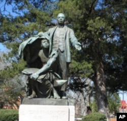 """This statue, titled, """"Lifting the Veil,"""" is a centerpiece of the Tuskegee campus. It depicts Booker T. Washington lifting the veil of ignorance from a former slave."""