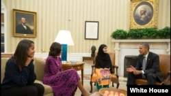 President Barack Obama, first lady Michelle Obama, and their daughter Malia meet with Malala Yousafzai, the young Pakistani schoolgirl who was shot in the head by the Taliban a year ago, in the Oval Office on October 11.