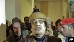 Moammar Gadhafi arrives at a hotel in Tripoli to give television interviews, March 8, 2011
