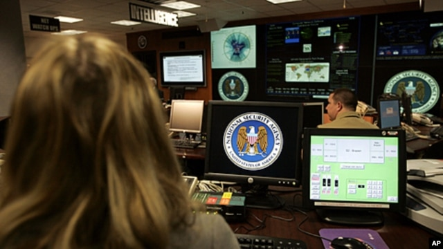 Employees of the National Security Agency work in the Threat Operations Center in Fort Meade, Maryland. (2006 file photo)