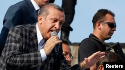 Turkey's PM Erdogan addresses his supporters in Ankara, June 9, 2013.