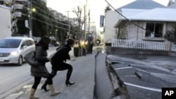 Japan's massive 8.9-magnitude earthquake collapsed a pedestrian road in Urayasu city, Chiba prefecture, Japan, March 11, 2011.