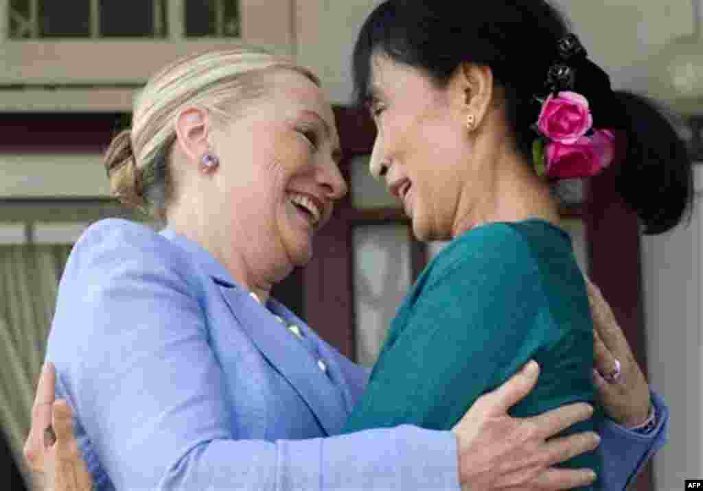 Myanmar's pro-democracy opposition leader Aung San Suu Kyi, right, and U.S. Secretary of State Hillary Rodham Clinton embrace while speaking to the press after meetings at Suu Kyi's residence in Yangon, Myanmar Friday, Dec. 2, 2011. (AP Photo/Saul Loeb, P