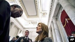 Peace Corps Director Aaron Williams (L) talks with Caroline Kennedy at the reception following a ceremony marking the 50th anniversary of President John F. Kennedy's inaugural address about the Peace Corps, on Capitol Hill in Washington, DC, January 20, 2