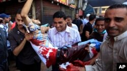 Egyptians evacuate a wounded man during clashes between security forces and supporters of Egypt's ousted President Morsi, Aug. 16, 2013.