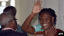 Ivory Coast's former first lady Simone Gbagbo waves as she arrives at the Court of Justice in Abidjan, Feb. 23, 2015