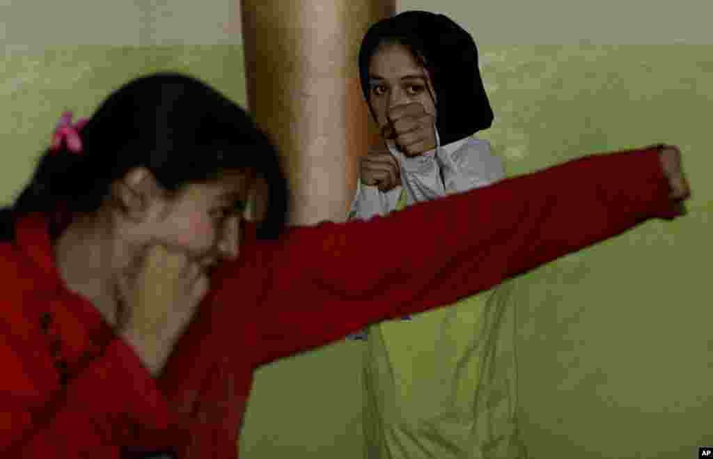 Afghan girls training to be boxers practice at the gym at Ghazi stadium in Kabul, Afghanistan, Oct. 23, 2007. The stadium is where the Taliban used to hold public executions in the late 1990s. This new generation is challenging the stereotype of Afghan wo
