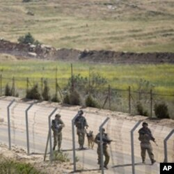 Israeli troops patrol along the border between Israel and Syria near the village of Majdal Shams in the Golan Heights, June 6, 2011