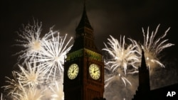 Fireworks explode over Elizabeth Tower housing the Big Ben clock to celebrate the New Year in London, Jan. 1, 2013.