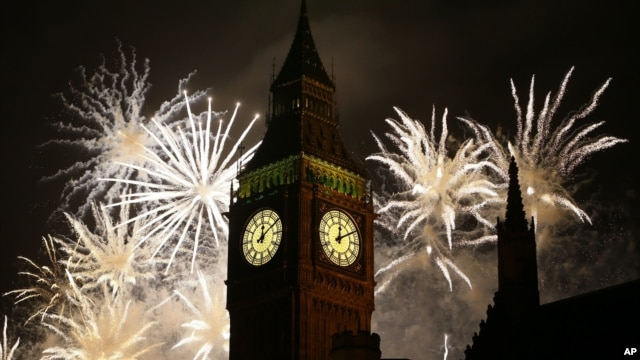 FILE - Fireworks explode over Elizabeth Tower housing the Big Ben clock to celebrate the New Year. The successful testing of a hyper-accurate clock could bring developments in physics and other areas of science.