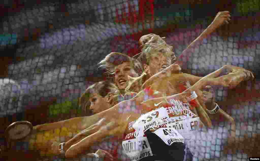 Nadine Mueller of Germany competes to win bronze in the women's discus throw final during the 15th IAAF World Championships at the National Stadium in Beijing, China.