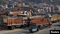 Trucks are seen parked in an open lot near a national highway on the outskirts of Ahmedabad, India, Dec. 2, 2015.