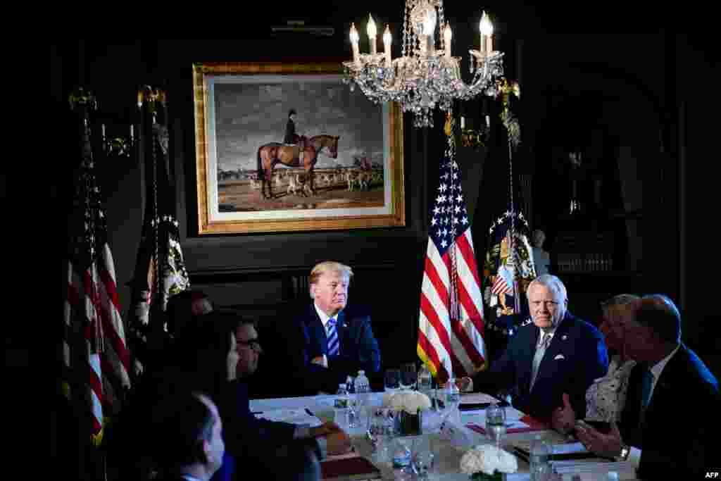 پرزیدنت ترامپ و مقامات ایالت نیوجرسی در جلسه اصلاح قوانین زندانهای آمریکا که در کلوپ ملی گلف ترامپ در نیوجرسی برگزار شد.