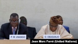 Former Nigerian President Olusegun Obasanjo (R) addresses a special UN Human Rights Council session on South Sudan in Sept. 2014, as South Sudan Justice Minister Paulino Waniwilla Unango listens.