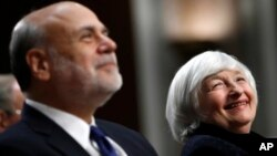Federal Reserve Chair Janet Yellen, right, and former Federal Reserve Chair Ben Bernanke smile during introductions at a ceremony awarding them both with the Paul H. Douglas Award for Ethics in Government on Capitol Hill in Washington, Nov. 7, 2017.