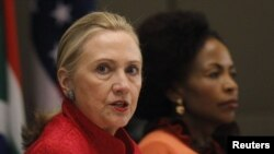 U.S. Secretary of State Hillary Clinton (L) speaks next to South African Foreign Minister Maite Nkoana-Mashabane during the U.S.-South Africa Strategic Dialogue in Pretoria, August 7, 2012.