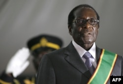 FILE - Zimbabwean President Robert Mugabe is sworn in for a sixth term in office in Harare, June 29, 2008.