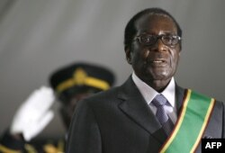 Zimbabwean President Robert Mugabe is hastily sworn in for a sixth term in office in Harare, on June 29, 2008 after being declared the winner of a one-man election. The 84-year-old veteran was boycotted by opposition leader and first-round winner Morgan T