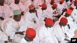 FILE - In this photo taken on Thursday, Dec. 19, 2013. Nigerian Muslim men attend a mass wedding in Kano, Nigeria.
