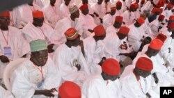 FILE - In this photo taken on Thursday, Dec. 19, 2013. Nigerian Muslim men attend a mass wedding in Kano, Nigeria.