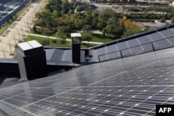 Panels of a photovoltaic power station are installed on the roof of a building in the new Clichy-Batignolles district in Paris, Oct. 22, 2012.