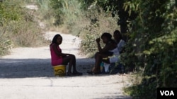 Three young women from Benin City wait in the shade of a lane for clients on the outskirts of Pozzuoli near Castel Volturno. The girls said they had been in Italy for two years. (J. Dettmer/VOA)