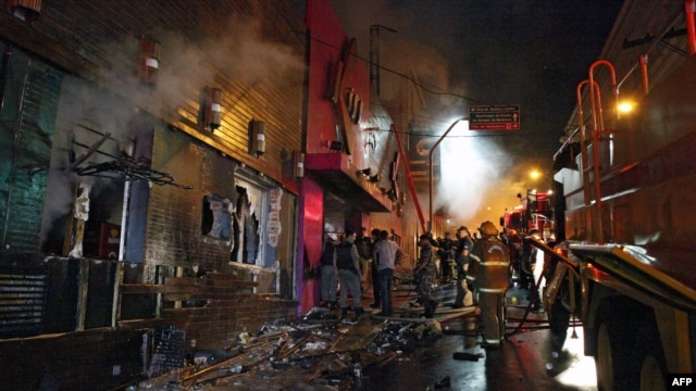 Firefighters try to put out a fire at a nightclub in Santa Maria, 550 Km from Porto Alegre, southern Brazil on January 27, 2012.