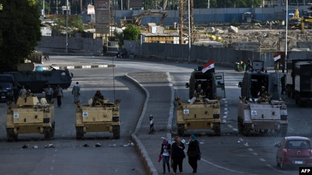 Egyptian army armoured personnel carriers (APC) are seen stationed in front of the Egyptian Museum in Tahrir Square in Cairo, Aug. 18, 2013.