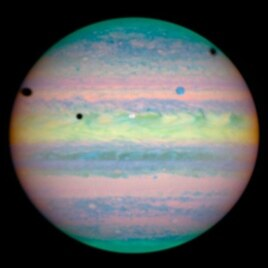 Hubble's image of three moons casting shadows on Jupiter