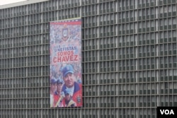 A government building in Caracas displays a poster with an image of the late Venezuelan President Hugo Chavez, Apr. 11, 2013.