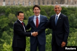 From left, Mexico's President Enrique Pena Nieto, Canada's Prime Minister Justin Trudeau and U.S. President Barack Obama pose for family photo at the North American Leaders' Summit in Ottawa, Ontario, Canada, June 29, 2016.