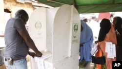 People thump print ballot papers during gubernatorial election in Kaduna, Nigeria, Thursday, April 28, 2011. Two states in Nigeria's Muslim north voted Thursday for state gubernatorial candidates after their polls were delayed by violence that killed at