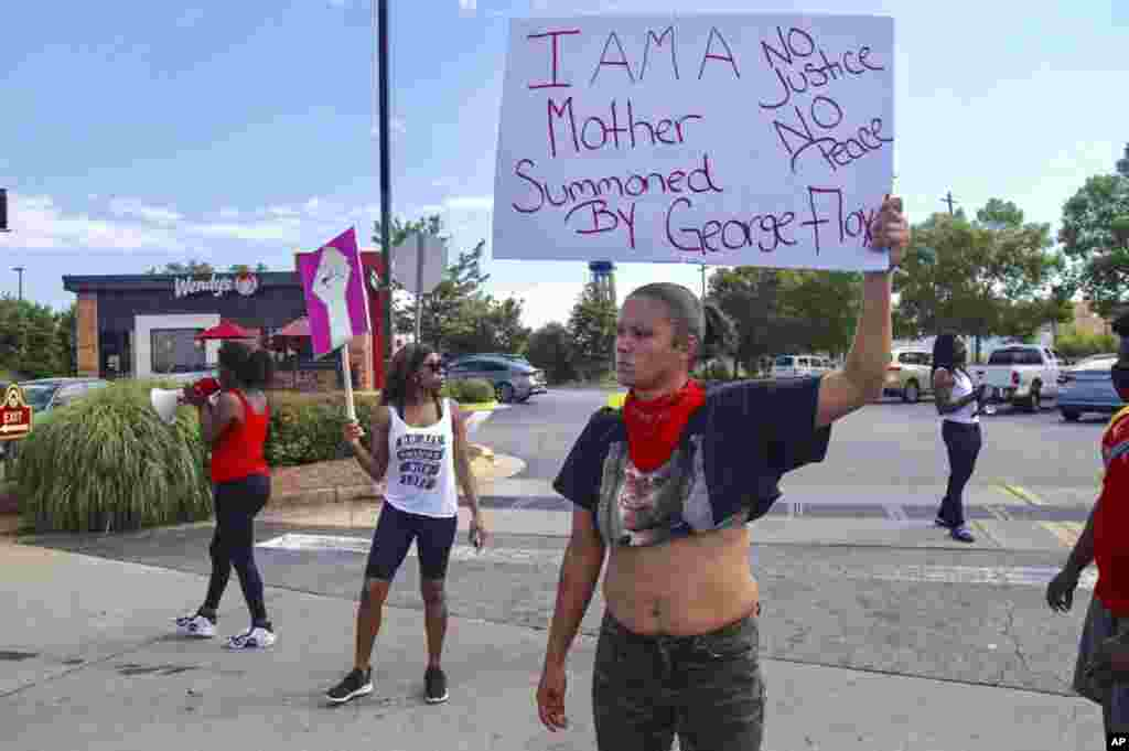 Protestors gather outside the Wendy's fast food restaurant in Atlanta on Saturday, June 13, 2020, where Rayshard Brooks, a 27-year-old black man, was shot and killed by Atlanta police Friday evening during a struggle in a drive-thru line. (Steve Schaefer/