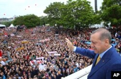 FILE - Turkey's President Recep Tayyip Erdogan waves to supporters as he arrives for a congress of the ruling Justice and Development Party (AKP) in Ankara, May 21, 2017.