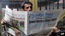 A man reads a Kurdish newspaper in southeastern city of Diyarbakir, Turkey, March 22, 2009.