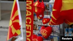 FILE - Souvenirs with the flag and name of Macedonia written on them are displayed in Skopje, Macedonia, Jan. 10, 2018.