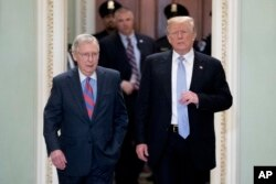 FILE - President Donald Trump, accompanied by Senate Majority Leader Mitch McConnell of Kentucky, left, arrives for a Senate Republican Policy lunch on Capitol Hill in Washington, May 15, 2018.