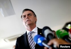 Brazil's President-elect Jair Bolsonaro talks to the media, in Brasilia, Brazil, Nov. 7, 2018.