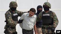 "FILE - Joaquin ""El Chapo"" Guzman is escorted to a helicopter in handcuffs by Mexican navy marines at a navy hanger in Mexico City, Feb. 22, 2014."